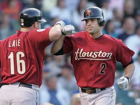 Houston Astros' Jason Lane, left, congratulates Chris