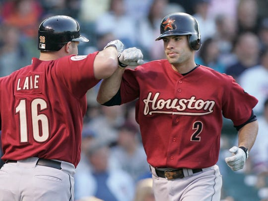 Houston Astros' Jason Lane, left, congratulates Chris Burke after Burke hit a solo homer off Chicago Cubs starting pitcher Sean Marshall during the first inning of a Major League Baseball game in Chicago, Tuesday, June 13, 2006. (AP Photo/Brian Kersey)