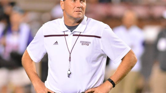 Mississippi State head coach Dan Mullen watches players