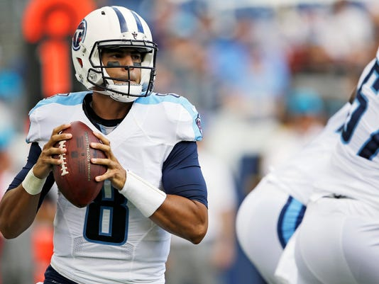 FILE - In this Aug. 20, 2016, file photo, Tennessee Titans quarterback Marcus Mariota (8) works against the Carolina Panthers in the first half of an NFL preseason football game, in Nashville, Tenn. (AP Photo/James Kenney, File)