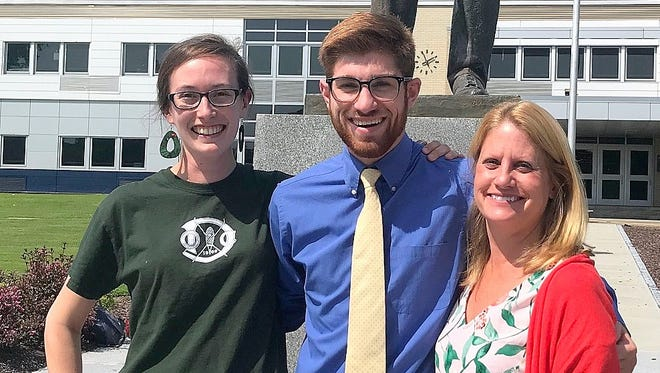 Recent Elmira High School graduate Garret Andreine designed and built a fitness trail for Tanglewood Nature Center to earn the Ernie Davis Scholarship award. With Andreine are Tanglewood Community Relations Manager Bridget Sharry, left, and Executive Director Elaine Spacher.
