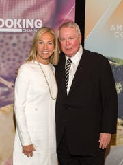 Dee Haslam and her father, Ross Bagwell Sr., are shown at the Knoxville Chapter of the American Marketing Association 28th annual Honors Ceremony, held Thursday, May 5, at the headquarters of Scripps Networks Interactive.