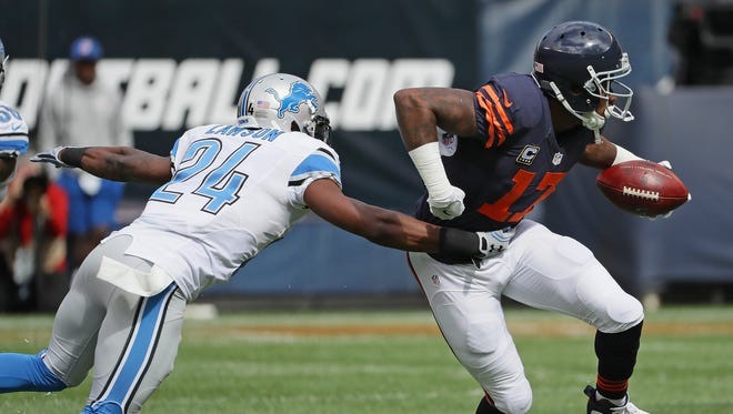 Alshon Jeffery of the Chicago Bears tries to break away from Nevin Lawson of the Detroit Lions after a catch at Soldier Field on October 2, 2016 in Chicago, Illinois.