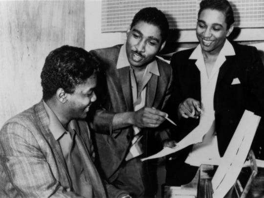 Eddie Holland, center, formed a songwriting team with