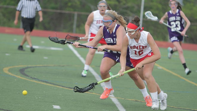 Somers' Livy Rosenzweig (right) and John Jay's Annie Conway both fight for a ground ball during a Section 1 girls lacrosse tournament Class B semifinal game between Somers and John Jay at Fox Lane High School on Monday, May 23rd, 2016. Somers won 13-4.