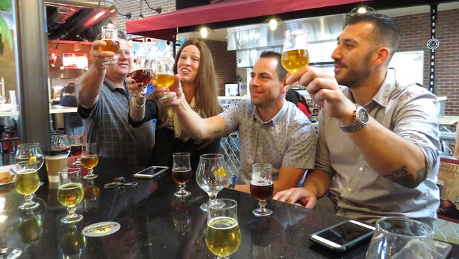 From left, Best in Fest Brewery Competition judges                                Kevin Pratt, Erin Peters, Jason Hendrick and Jorge Alem toast one another with tasters of their respective picks for first place. Chief Peak IPA by Topa Topa Brewing Co. in Ventura took the honor, with a score of six-to-one.