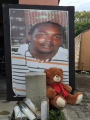 A picture of Gregory Hill Jr., rests against the garage door of his home on Wednesday, January 20, 2016. Gregory Hill Jr. was killed in January 2014 after a confrontation with St. Lucie County deputies at his home in the 1500 block of Avenue Q in Fort Pierce.