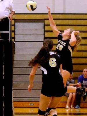 Central Magnet's Meredith Page (18) hits the ball over the net during a recent match. She had seven kills and four blocks in a 3-0 win over Eagleville Monday.