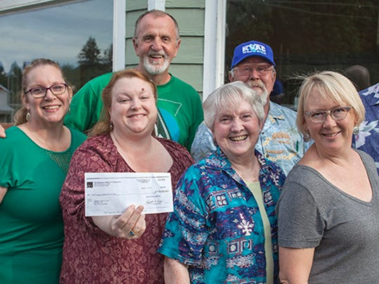 Santiam Hearts 2 Arts members share a photo of their recent $5k gift.