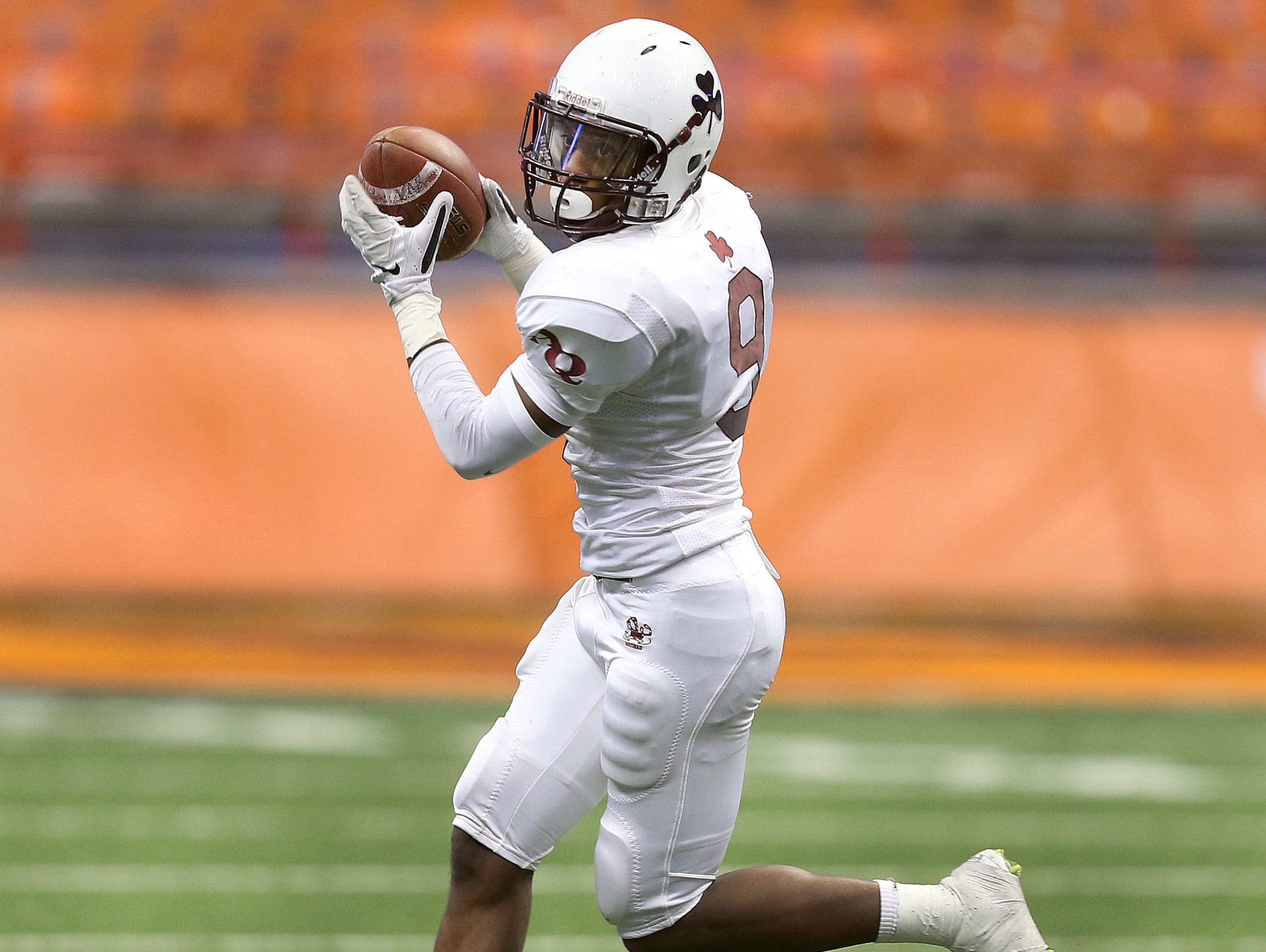 Aquinas' Earnest Edwards looks for running room after a catch.