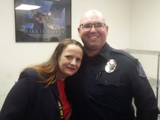Officer Lavin and Tavia Warner