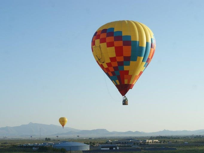 Balloons fly over Deming, New Mexico during the Solitaire