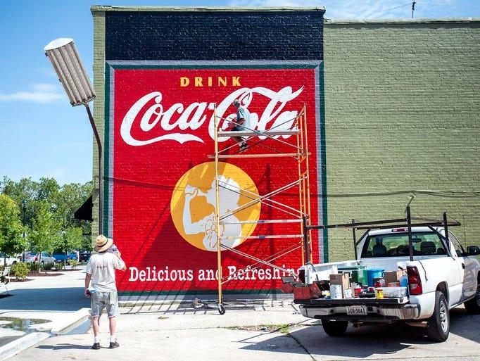 Historic coke murals return to n c city for Coca cola wall mural