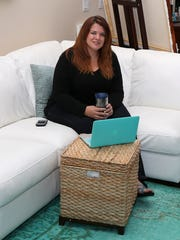 Lucinda Sperry operates her graphic design business from her home in Norwalk.