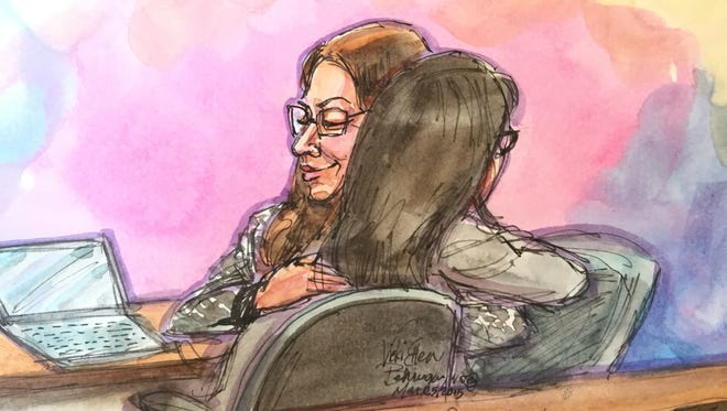 Ellen Pao, who is suing venture capital firm Kleiner Perkins Caufield & Byers, hugs her lawyer, Therese Lawless, after closing arguments in the case ended March 25, 2015.