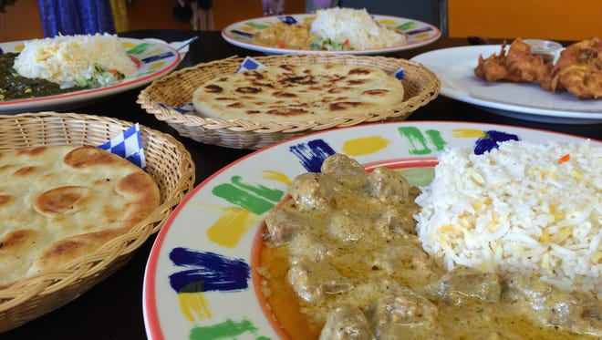 Bombay CafŽ in Cedar City offers a variety of lamb, chicken and vegetable dishes, including the Lamb Curry in the foreground.