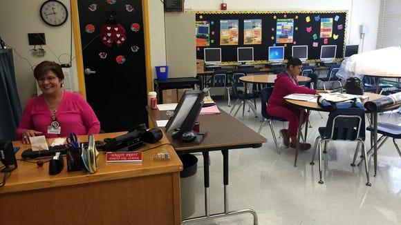 Terrace Hills Middle School parent liaison Maggie Pratt, left, sits in the school's parent center on Oct. 27.