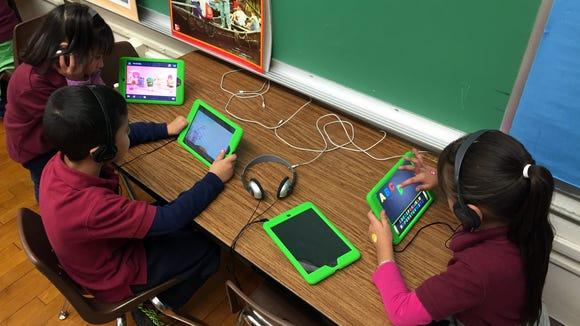 Zavala Elementary School students use programs on iPads.
