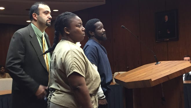 Kimberly Murphy, front, stands with her attorney, Nijad Mehanna, and codefendant, Harold Murphy, for the couple's sentencing in the 2013 death of their 11-month-old daughter who ingested a prescription morphine pill. The sentencing was delayed until Feb. 9 in Macomb County Circuit Court because Harold Murphy's attorney was ill Jan. 20, 2016.