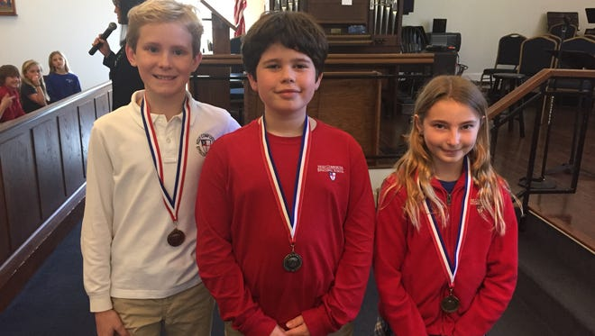 The winners of the Pilot Club essay contest pose for a photo after reading their essays aloud. From left to right: Davis Wagnon received third place; Harrison DeGuire, second place; and Hayden Bevis, won first place.