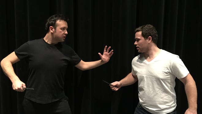 "Michael Mendez (left) plays Bernardo, leader of the Sharks, and Michael Jacobs plays Riff, leader of the Jets, in the UWFV production of ""West Side Story."""