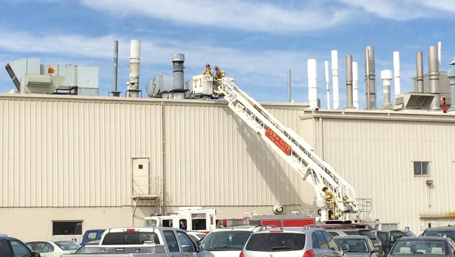 The Iowa City Fire Department fights a fire on the roof of the International Automotive Components plant at 2500 Highway 6 on Thursday morning. No one was hurt.