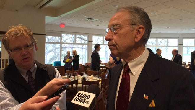 U.S. Sen. Chuck Grassley speaks with reporters after a meeting with the Des Moines A.M. Rotary on Friday.