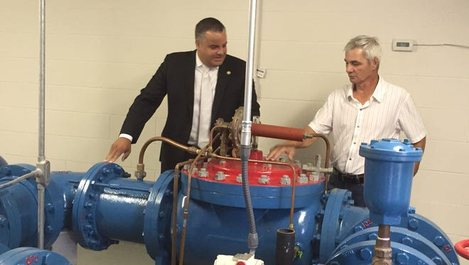 Binghamton Mayor Richard David, left, and Water Superintendent Joe Yannuzzi on Thursday discuss federal tests of water in the city.