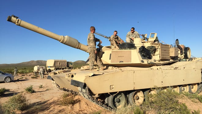 A tank crew from Charlie Company, 1st Battalion, 6th Infantry Regiment participates in the new Army Warfighting Assessment in October.