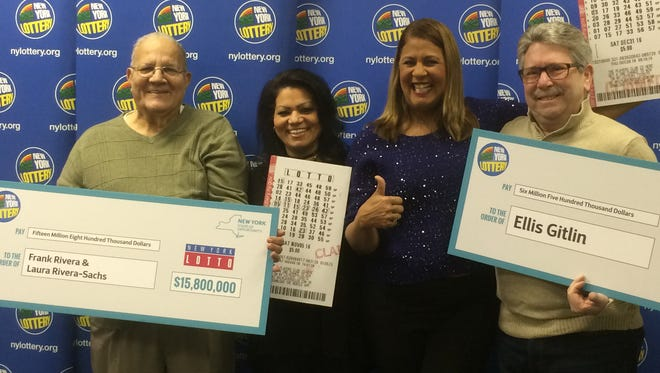 Frank Rivera and daughter Laura Rivera-Sachs, of Suffern, left, and Ellis Gitlin of New City, right, were presented their combined  $22.3 million in lottery winnings during a ceremony Feb. 10, 2017. Yolanda Vega, second from right, presented their ceremonial checks.