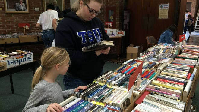 Customers search through the offerings during a past Friends of Morrisson-Reeves Library book sale.