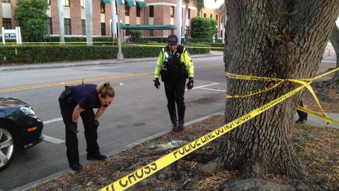 Police investigate a shooting along 14th Avenue in Vero Beach March 31, 2017.