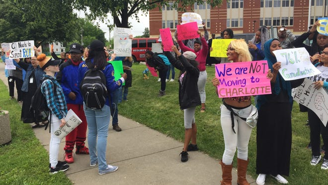 Students and staff at Rochester Early College International High School protest a proposed move to the Charlotte campus.