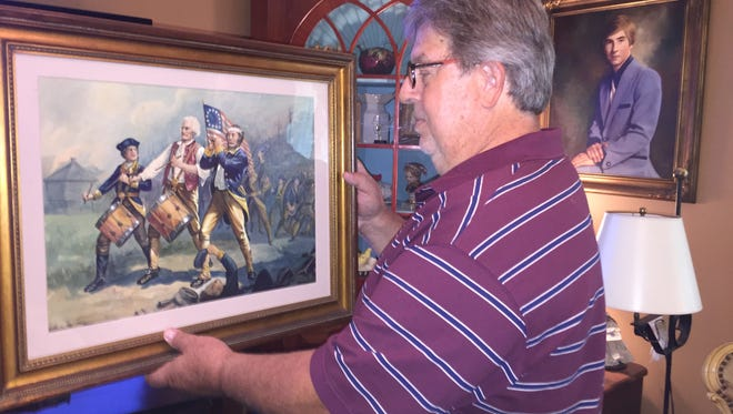 """Port St. Joe resident Jay Stevens hold his """"original copy"""" of the famous Spirit of '76 painting by Archibald Willard. Stevens bought the painting in the late 1970s and recently discovered it may be worth more than $1 million."""