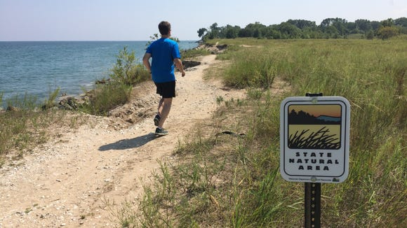 Bob Dohr runs along Lake Michigan on the Kenosha Sand
