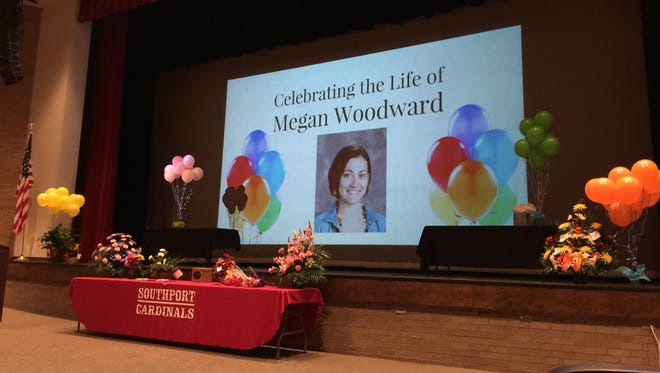 A memorial ceremony for 29-year-old Megan Woodward, who died Sept. 29 after falling from a float she was decorating for the school's homecoming celebration.