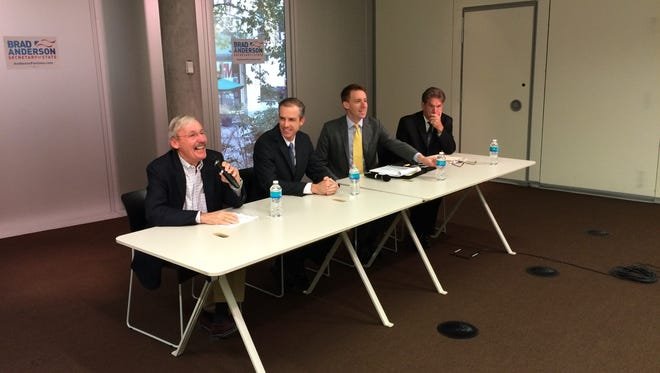 From left to right, moderator Mike Glover, Iowa Secretary of State candidate Brad Anderson, Missouri Secretary of State Jason Kander and Minnesota Secretary of State Mark Ritchie hold a forum at the Des Moines Central Library.