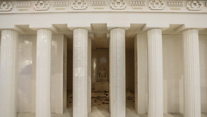 A large-scale LEGO model of the Lincoln Memorial includes a detailed LEGO sculpture of Abraham Lincoln. The model is one of 10 replicating some of our nation's landmarks.