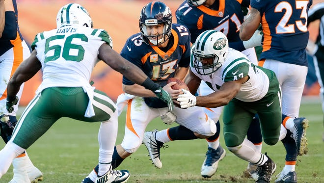 Dec 10, 2017; Denver, CO, USA; Denver Broncos quarterback Trevor Siemian (13) is sacked by New York Jets outside linebacker David Bass (47) and inside linebacker Demario Davis (56) in the second quarter at Sports Authority Field at Mile High. Mandatory Credit: Isaiah J. Downing-USA TODAY Sports