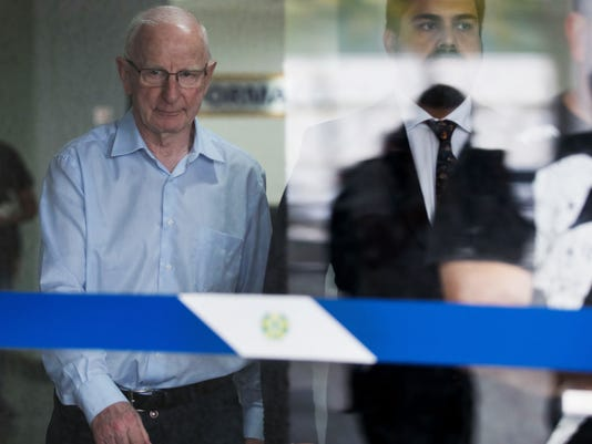 President of Ireland's Olympic Council Patrick Hickey, left, leaves a police station in Rio de Janeiro, Brazil, Tuesday, Sept. 6, 2016. The high-ranking Olympic official is declining to answer police questions related to alleged ticket scalping during last month's Olympic Games. Hickey must remain in Brazil until the probe is concluded. (AP Photo/Mauro Pimentel)