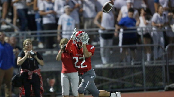 Tappan Zee's Tommy McGivney catches a touchdown pass during Friday night's game against Pearl River at Tappan Zee High School in Orangeburg.  Tappan Zee won 25-7.