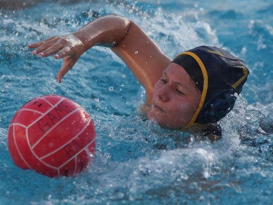 Xavier Prep and La Quinta battle during a water polo