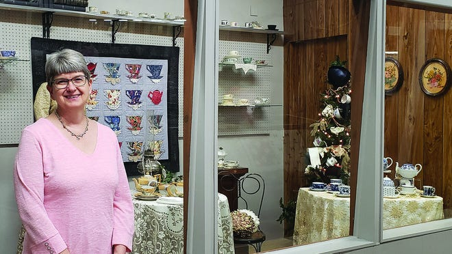 "Sue Buhler shares her extensive tea cup collection with visitors at the Pratt County Historical Museum and with 50 area women who attended a ""high tea"" event last Thursday at the museum. The collection will be on display until March 31 at the museum."