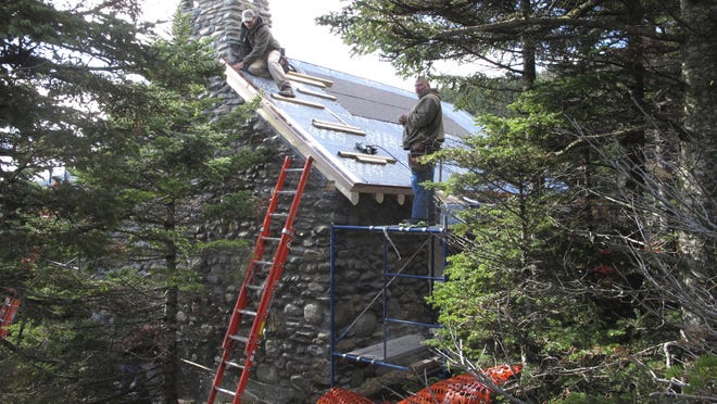 Workers rebuild a historic stone cabin on Mount Mansfield in Stowe. The building was gutted in a fire last Christmas Eve when the founder of Burton Snowboards' two sons accidentally caused a fire. The family donated $150,000 to help rebuild the Stone Hut, which will be open for overnight guests starting Dec. 1.