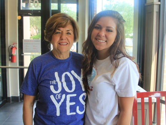 Camp volunteer Tish with her granddaughter, who survived