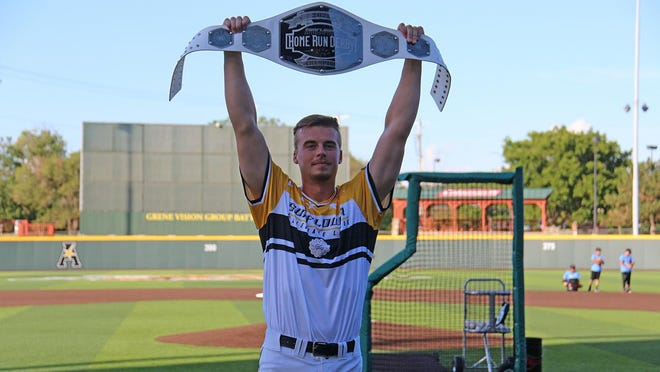 Garrett Kocis holds up his Championship Belt for winning the 2020 Sunflower Collegiate League Home Run Derby. He hit 10 home runs, beating Cheney's Jackson Glenn's nine home runs