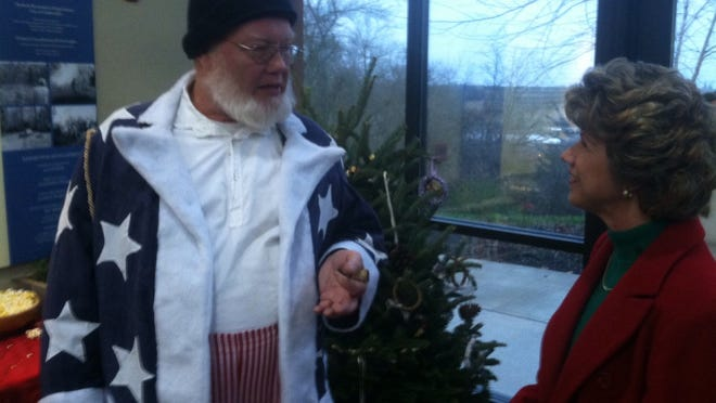 "Santa Claus, circa 1863, chats with Clarksville Mayor Kim McMillan during ""Christmas in Occupied Clarksville"" at the Fort Defiance Interpretive Center in 2013."