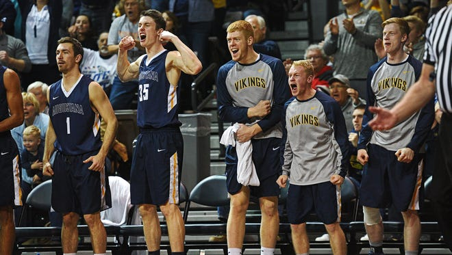Augustana players celebrate from the bench after a teammate scored during an NSIC Men's Basketball Championship semifinal game against Southwest Minnesota State Monday, Feb. 27, 2017, at the Sanford Pentagon in Sioux Falls. Augustana fell to Southwest Minnesota State 97-89 in double overtime.
