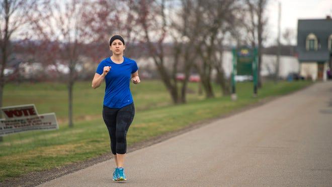 Vestal resident Trisha Chambers, 29, runs along the Vestal Rail Trail on Friday, April 1, 2016.