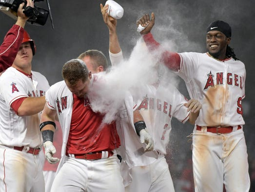 April 25: Angels right fielder Kole Calhoun (56) celebrates